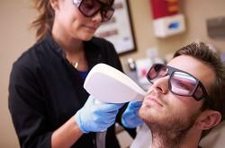 Image of Man Having Laser Treatment At Beauty Clinic