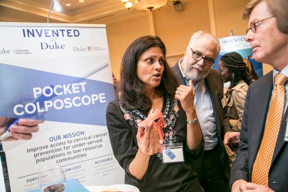 Nimmi Ramanujam, Professor of Biomedical Engineering, talks with President Vincent Price about a novel pocket colposcope she developed to make cervical cancer screening easier and more sustainable in low-to-middle-income countries, during Invented at Duke's 1st Annual Celebration event at the Washington Duke Inn. The 1st Annual Celebration, Invented at Duke: Celebrating Invention, Entrepreneurship & Innovation, at Washington Duke Inn. With over 300 inventions, 85 issued patents, and 11 new start-ups this year, Duke is turning world class research into viable commercial products. University researchers talk about their commercializing technologies, such as a puncture proof vascular graft, silicone microspheres, improved eye disease imaging, and many other cutting-edge innovations generated by the more than $1 billion in research conducted annually at Duke. Hosted by Duke OLV and Duke I&E, #InventedatDuke Celebration brings together leaders from local industries, business, and venture capitalists, researchers and community, to celebrate the many accomplishments of Dukeís innovators. President Vincent Price makes remarks to highlight the breadth of Duke discoveries.