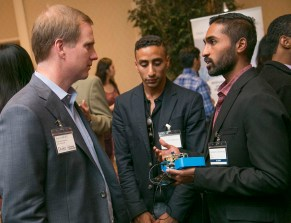 OLV Team Member, Rob Hallford, chats with a Duke Alumni and a member of the local community about inventions, innovation, and entrepreneurship. Photo by Jared Lazarus/Duke Photography