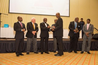 Kenmore Bynoe accepting his IOC Trophy award for his outstanding contributions to the Olympic movement