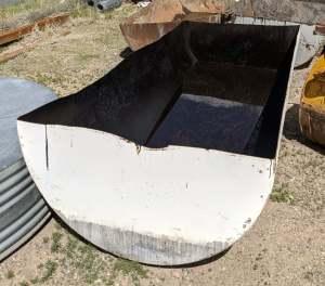 metal storage tank cut in half lengthwise