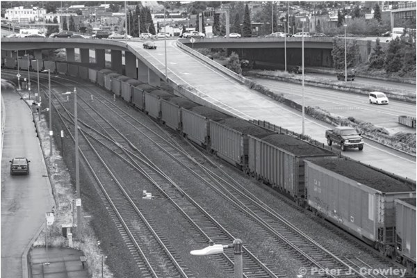 A coal train travels through downtown Tacoma