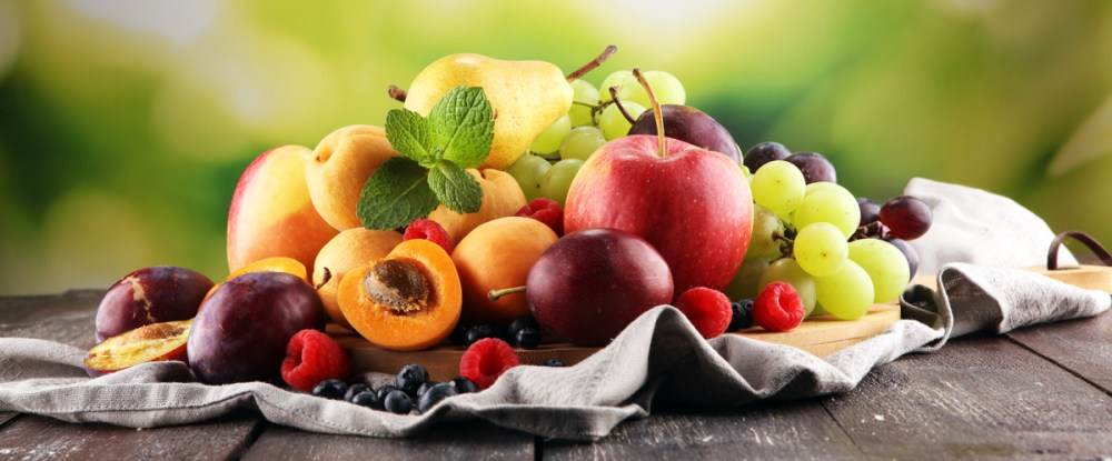 Fresh summer fruits with apple, grapes, berries, pear and apricot.