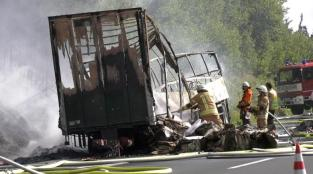 Firefighters are seen at the site where a coach burst into flames after colliding with a lorry on a motorway near Muenchberg, Germany in this still image taken from video on July 3, 2017. REUTERS/News 5
