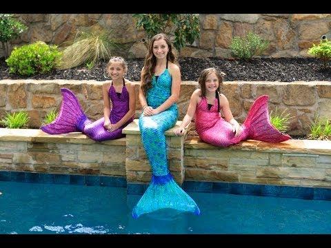Live mermaids swimming
