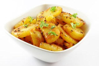 fried potatoes on a white background - Bratkartoffel auf weiem