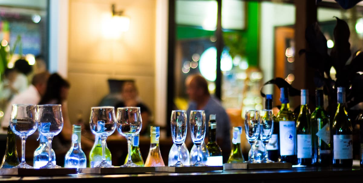Wine glasses and bottles on bar, how to detox your liver from alcohol