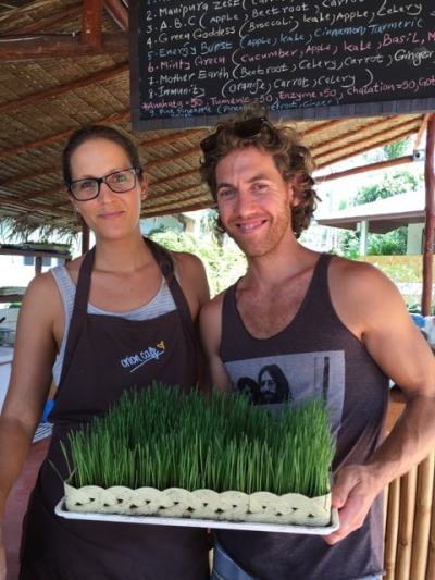 Derek and Dominique with a fresh tray of Wheatgrass