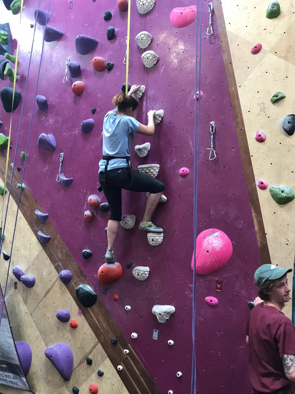 Picture of female client indoor rock climbing
