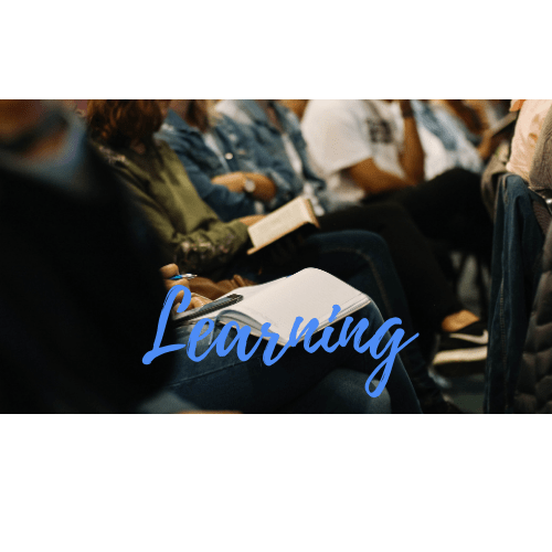 A Group of People Making Notes with the Word Learning Written on the Image