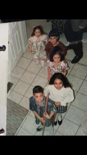 Cousins splitting the red sea at our seder in 1994