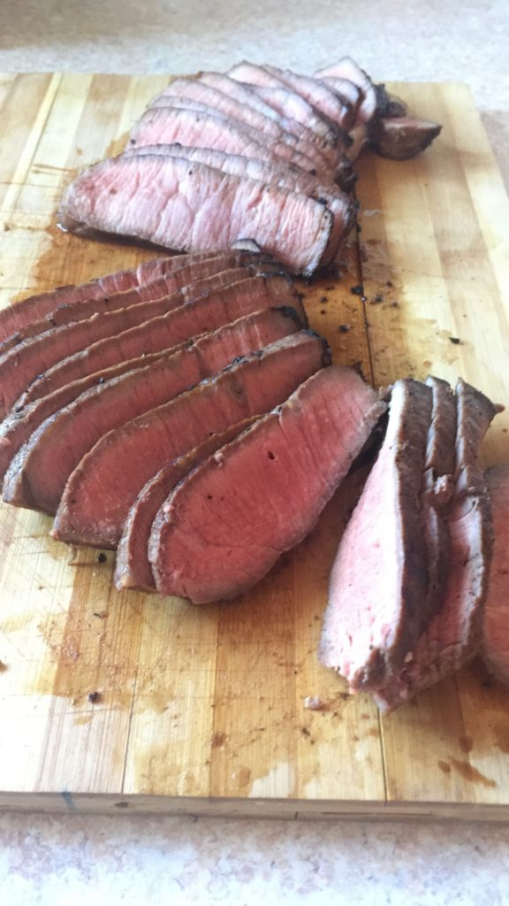 Marinated, reverse seared london broil steak