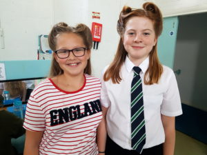 Evie and Honey learning how to do vintage hair as part of their bronze Arts Award