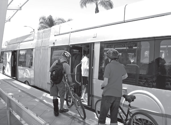 Riders boarding train with bike