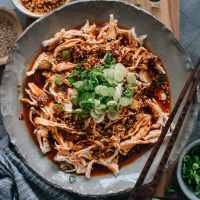 Chinese Bang Bang Chicken (棒棒鸡) - The real-deal Sichuan version of Bang Bang chicken made with juicy tender shredded chicken breast covered with a savory, nutty, spicy sauce with a hint of tangy and sweet notes. Originally a traditional Chinese appetizer, make it ahead and serve it at your next movie night or game day party. Mind blow guaranteed.