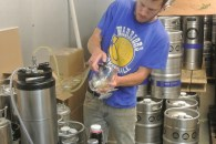 Barry pours some beer from their kegs in the coldest room in the brewery