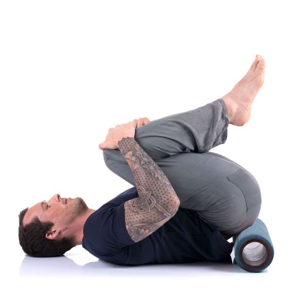 Om Roller 5-inch with Indigo cover in sacrum rolling position