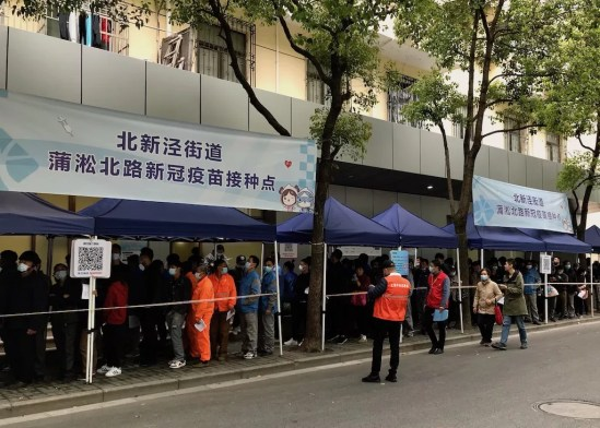 People wait in line for the vaccine in China - onaroadtonowhere.com