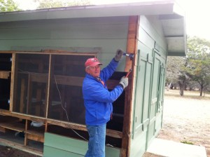 The guys rebuilt/updated a twenty person cabin.  Old siding comes off.  Process begins.