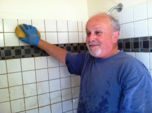 Tony applying grout to tile of SEVERAL bath rooms.