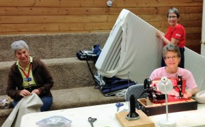 Markay, Kim and Jenny refitted and repaired mattress covers by the ten's. Bunches!!