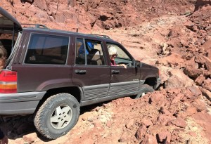 This what happens when the road falls away from the front of Bill's Jeep while the group went 4-wheeling in the desert hills.