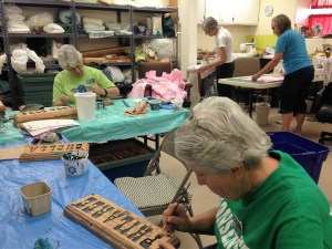 The ladies painted new signs and did a butch of sewing for the camp. Betty in the foreground, --------