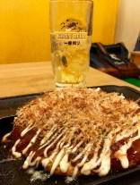 Okonomiyaki - a savoury pancake filled with prawns (in this case) as well as flour, cabbage and other flavours. Umeshu (a Japanese plum wine) with soda water served in the background