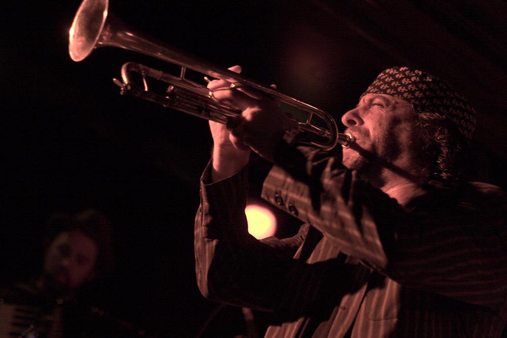 Frank London blows his trumpet.