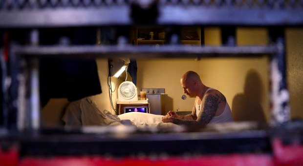 An inmate sits in his cell at San Quentin State Prison's death row on August 15, 2016 in San Quentin, California.