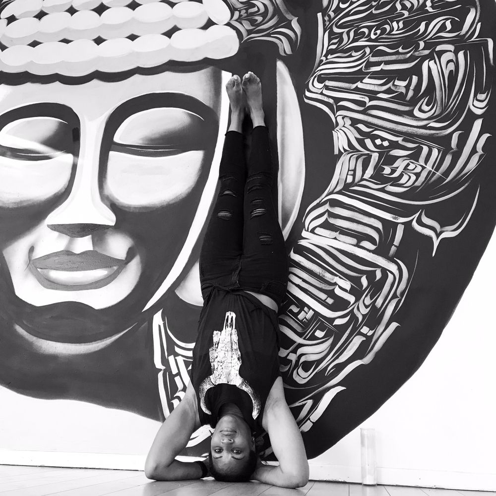 A woman does a headstand at Studio 262.