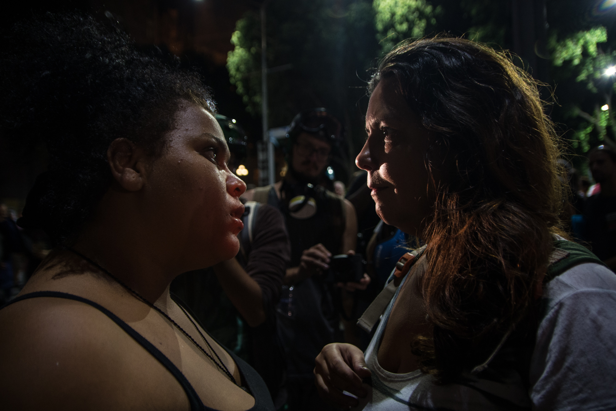 Demonstrators argue during a national protest against the social welfare reform bill introduced by the government of President Michel Temer, which seeks to extend the years of contributions and raise the minimum age for retirement, in Rio de Janeiro, Brazil on March 31, 2017.