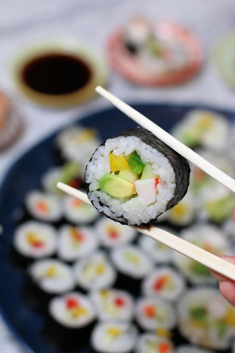 maki sushi with avocado crab stick yellow pepper cucumber jalapeno