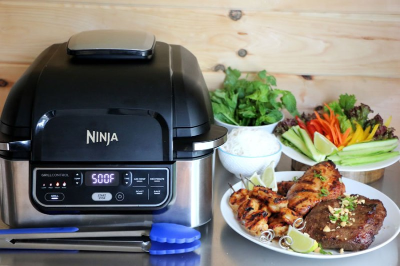The Ninja Foodi Grill With A Mixed Grill Platter