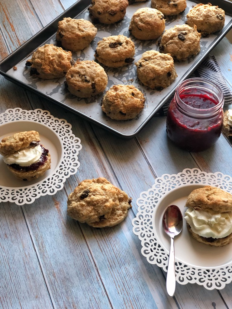 Flatlay with spelt buttermilk scones, jam and cream.