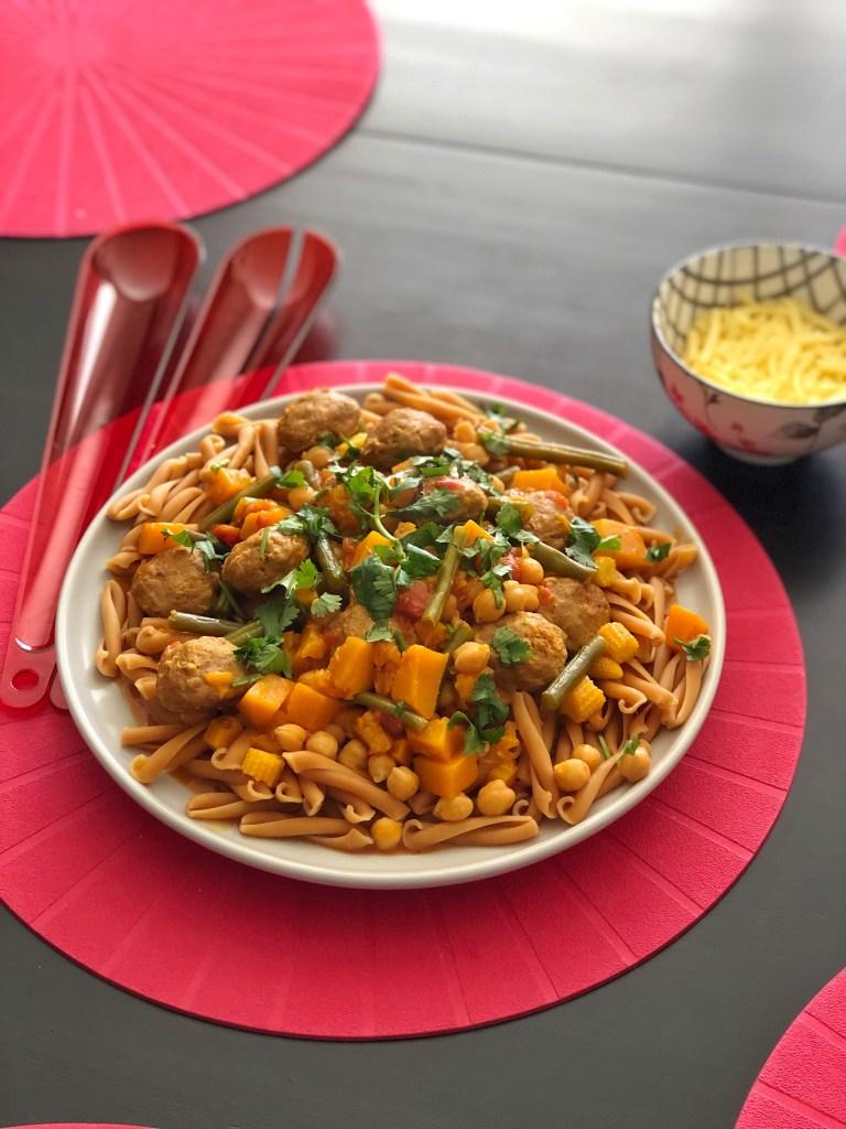 Meatball pumpkin curry on a plate.