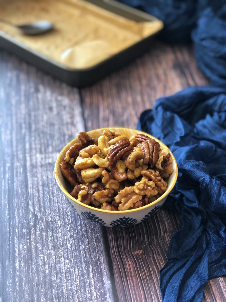 Sweet and salty mixed nuts in a bowl.