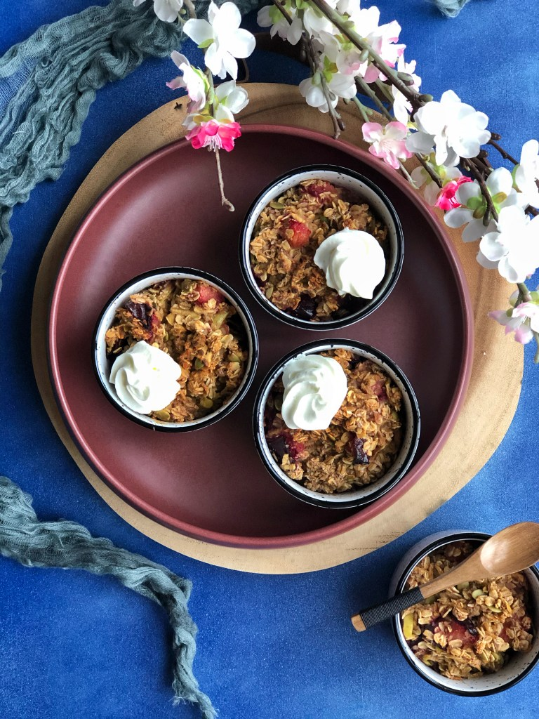 Individual baked apple and plum oat pots