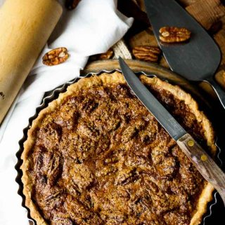 Sweet, rich and caramelly, filled with creamy, soft pecans and topped with toasted, praline like nuts, this pecan pie is quick and easy to make. A gorgeous autumn dessert.