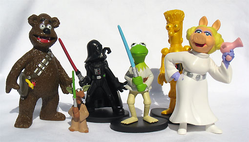 Muppet figures dressed in Star Wars costumes: Fozzy Bear as Chewbacca, some small character I don't recognise as Yoda, Gonzo as Darth Vader, Kermit as Luke Skywalker, Beaker as C3PO, Miss Piggy as Princess Leia