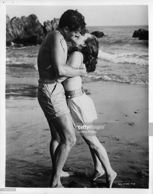 Farley Granger and Ann Blyth kissing on the beach in OUR VERY OWN 1950.