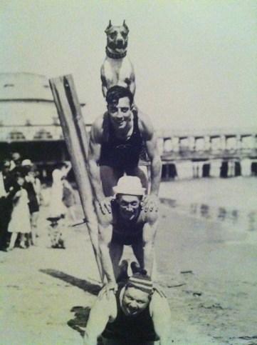 "Roscoe ""Fatty"" Arbuckle, Al St. John, Buster Keaton and Luke the Wonder Dog living the high life on the beach at Santa Monica."