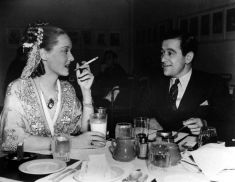 Bette Davis and Jezebel director, William Wyler, share lunch at the Warner Bros. commissary