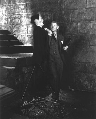 James Whale poses with a model of Frankenstein's monster on the set of Bride of Frankenstein, 1935.