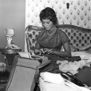 Loren typing in 1963