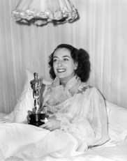 Joan Crawford with her Oscar for Mildred Pierce
