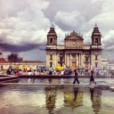 Children walking through the fountains of Guatemala City's Parque Central
