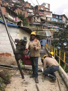 Construction workers in Comuna 13