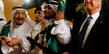 Trump in the traditional sword dance with the King of Saudi Arabia. Photo: Jonathan Ernst / Reuters (Detail).