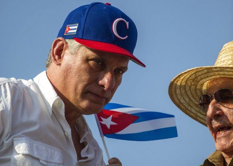 Cuban President Miguel Díaz-Canel and former President Raúl Castro, on May 1, 2018. Photo: Desmond Boylan / AP.